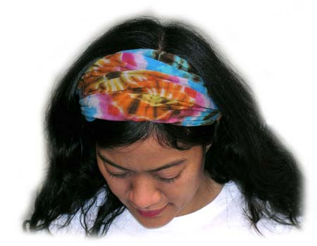 woman wearing mudmee tie dye hair band folded