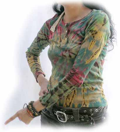 woman with subdued mudmee tie dye henley shirt